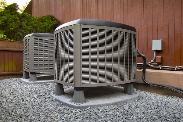 Dual HVAC Units Outside of Home in Summer