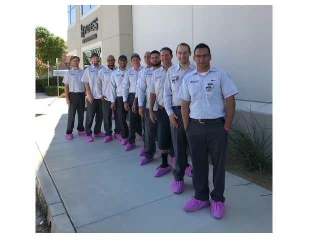 Hyde's HVAC techs wearing pink boots for Thyroid Cancer awareness month.