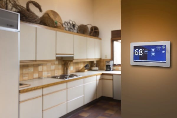 Thermostat In Home Near Kitchen Reading 68 Degrees