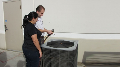 Hyde's technician check air conditioning system